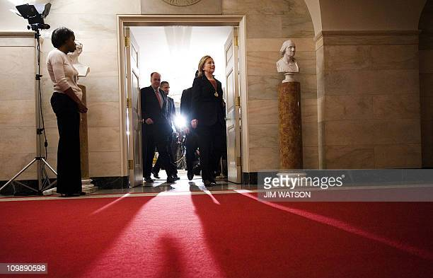 US Secretary of State Hillary Clinton exits the Diplomatic Room with US President Barack Obama and National Security Advisor Tom Donilon after Obama...