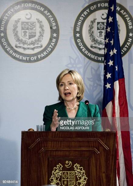 US Secretary of State Hillary Clinton gestures as she addresses media representatives during a press conference at the Foreign Minister office in...