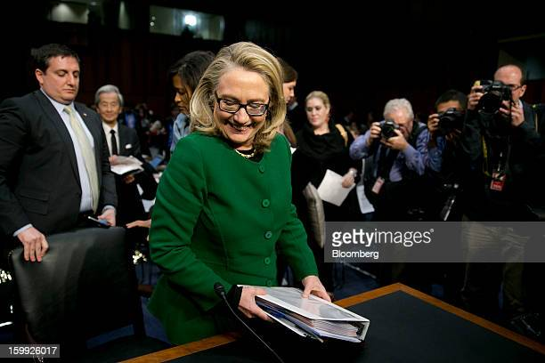 US Secretary of State Hillary Clinton gets out of her seat following a Senate Foreign Relations Committee hearing in Washington DC US on Wednesday...