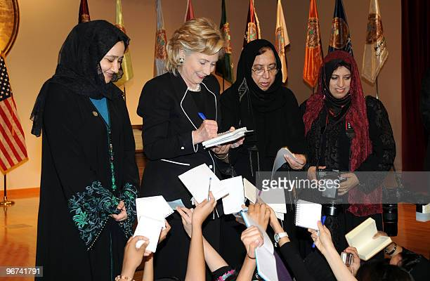 US Secretary of State Hillary Clinton gives her autograph to students at the Dar alHekma college for women during a 'town hall' meeting in the Red...