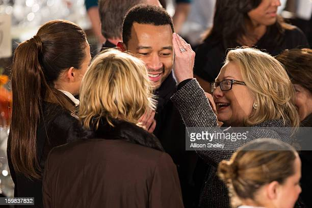 S Secretary of State Hillary Clinton greets singer John Legend and his fiance Christine Teigen at the Inaugural Luncheon in Statuary Hall on...