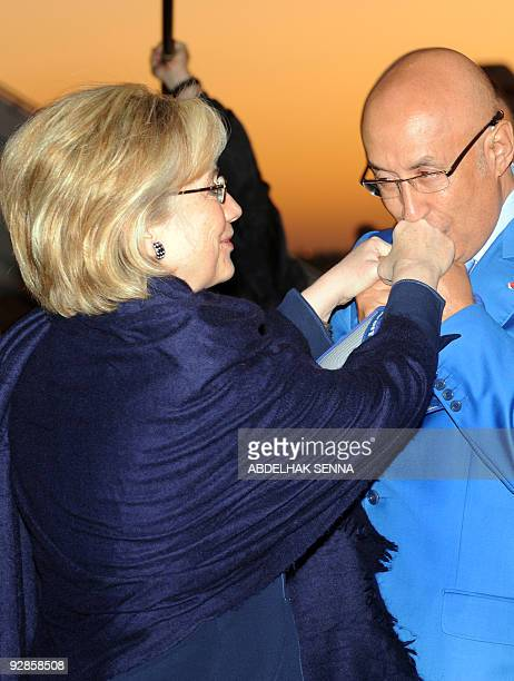 US Secretary of State Hillary Clinton is greeted by Abdeslam Jaidi Moroccan consul to the United Nation upon her arrival at Marrakech airport early...