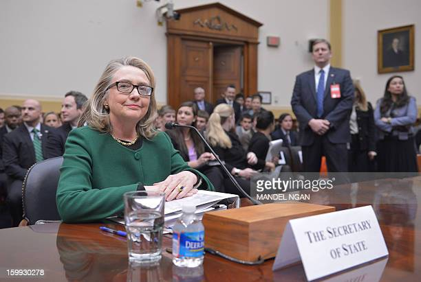 US Secretary of State Hillary Clinton is seated before testifying before the House Foreign Affairs Committee on the September 11 2012 attack on the...