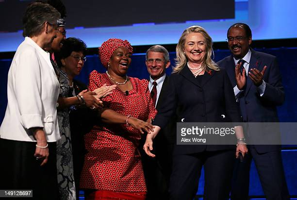 S Secretary of State Hillary Clinton is surrounded by UNAIDS Executive Director Michel Sidibé Director of the National Institute of Allergy and...