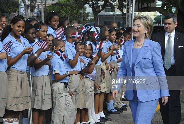 US Secretary of State Hillary Clinton is welcomed by schoolchildren upon her arrival for a visit at the Rosa Duarte school in Santo Domingo April 17...