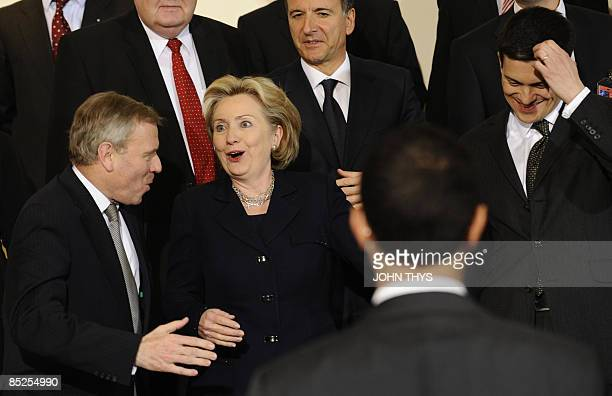 US Secretary of State Hillary Clinton jokes with NATO SecretaryGeneral Jaap de Hoop Scheffer and British Foreign minister David Miliband during a...
