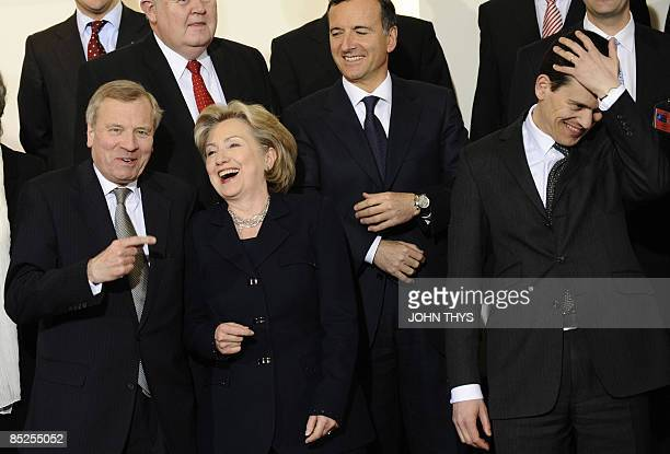 US Secretary of State Hillary Clinton jokes with NATO SecretaryGeneral Jaap de Hoop Scheffer Britain Foreign minister David Miliband and Italy's...
