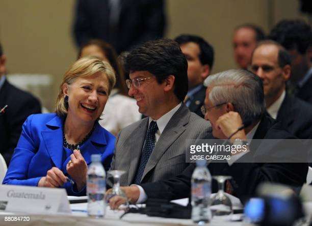 US Secretary of State Hillary Clinton laughs as she participates in the Pathways to prosperity meeting next to Guatemalan ViceMinister of Economy...