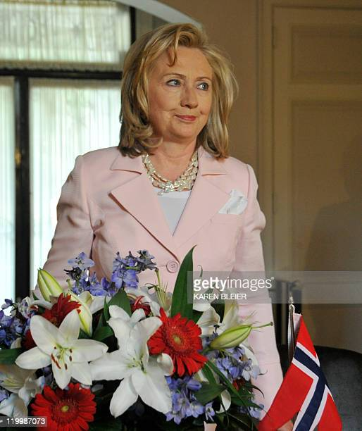 US Secretary of State Hillary Clinton leaves after signing a book of condolence at the Norwegian Embassy on July 28 2011 in Washington DC Clinton...
