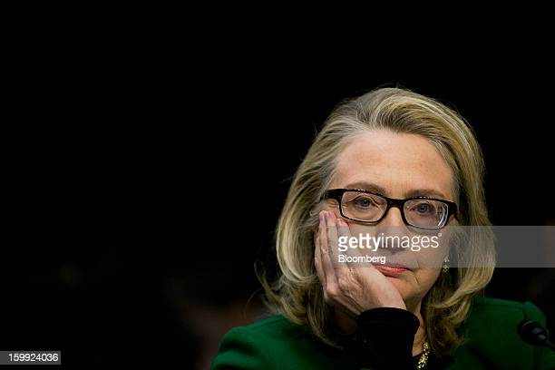 US Secretary of State Hillary Clinton listens to a question during a Senate Foreign Relations Committee hearing in Washington DC US on Wednesday Jan...