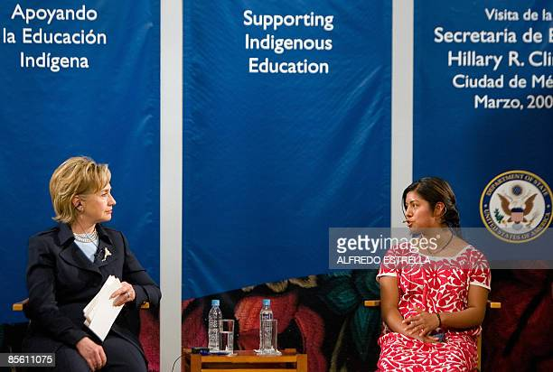 Secretary of State Hillary Clinton listens to indigenous woman Reyna Luz Santiago, at the Palace of Fine Arts in Mexico City, on March 25, 2009....