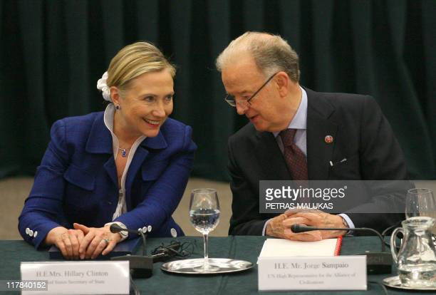 US Secretary Of State Hillary Clinton listens to Portugal's former president and UN High Representative Jorge Sampaio as they take part in the...