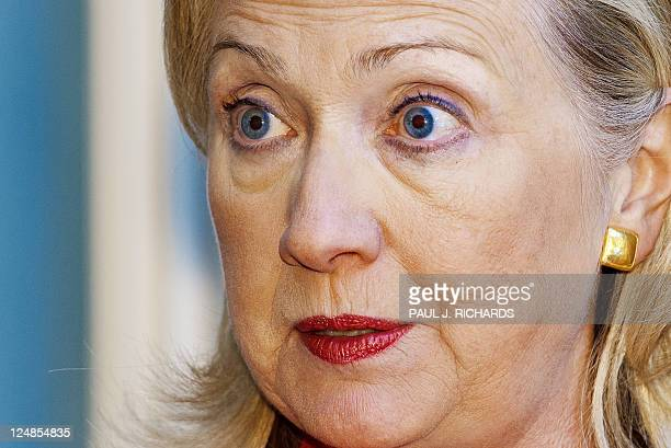 US Secretary of State Hillary Clinton listens to reporter's questions shortly after signing a Ballistic Missile Defense Agreement with Romanian...