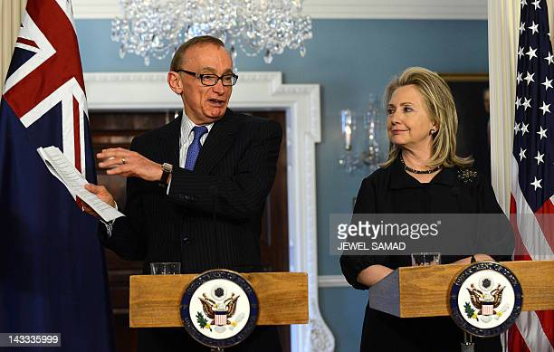 Secretary of State Hillary Clinton looks on as Australian Foreign Minister Bob Carr answers a question during a joint press conference following...