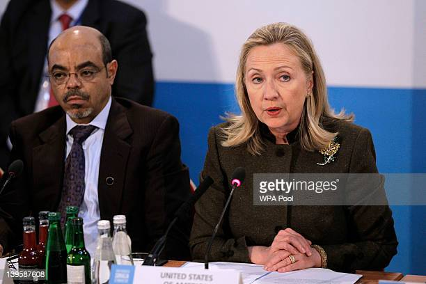 Secretary of State Hillary Clinton makes an address flanked by Ethiopia Prime Minister Meles Zenawi during the Somalia Conference at Lancaster House...