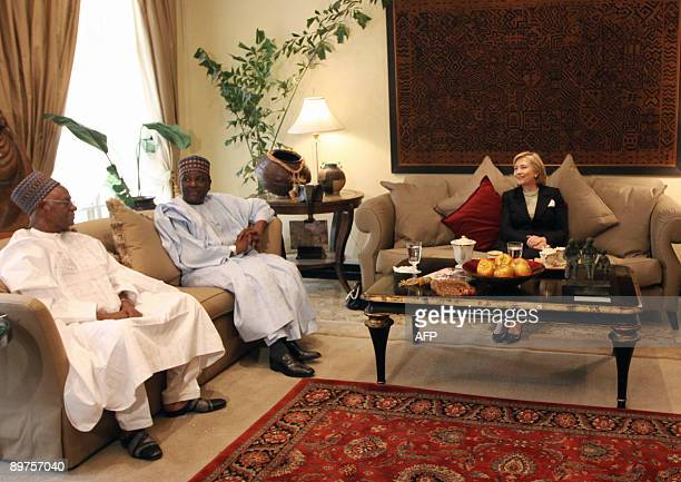 Secretary of State Hillary Clinton meets with former Nigerian heads of state Shehu Shagari, left, and General Yakubu Gowon, centre, in Abuja, on...