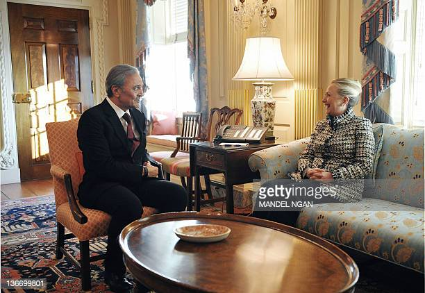 US Secretary of State Hillary Clinton meets with Saudi Foreign Minister Prince Saud al Faisal in her outer office at the State Department January 10...