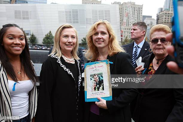 S Secretary of State Hillary Clinton poses with Carolyn Bilelis who lost her brother Craig Staub during the tenth anniversary ceremonies of the...