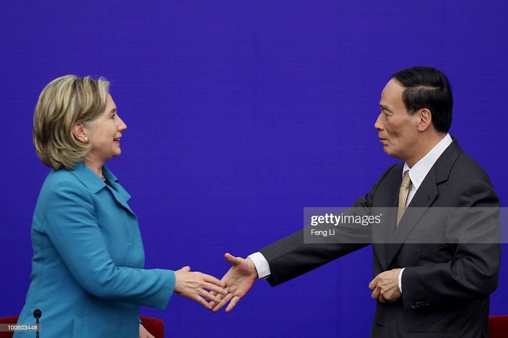 U.S. Secretary of State Hillary Clinton (L) shakes hands with China's Vice Premier Wang Qishan after a press conference for the China-U.S. Strategic and Economic Dialogue (S&ED) at the Great Hall of People on May 25, 2010 in Beijing, China. Hillary Clinton called upon Beijing to back international pressure against North Korea following the sinking of a South Korean warship, and to seek greater stability in the region.