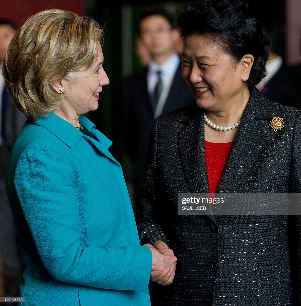 US Secretary of State Hillary Clinton (L) shakes hands with Chinese State Councilor Liu Yandong (R) prior to meetings at the National Center for the Performing Arts after meetings in Beijing on May 25, 2010. The United States and China were wrapping up strategic talks aimed at smoothing out differences on currency and trade issues, as Washington presses Beijing to get tough on North Korea. AFP PHOTO / POOL / Saul LOEB