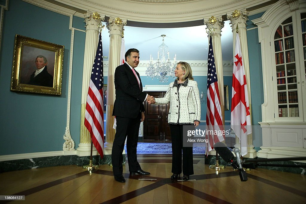 U.S. Secretary of State Hillary Clinton (R) shakes hands with Georgian President Mikheil Saakashvili (L) as they speak to members of the media after their meeting February 1, 2012 at the State Department in Washington, DC. President Saakashvili is on a state visit to Washington to mark the 20th anniversary of diplomatic relations between the United States and Georgia.