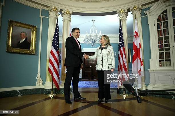 S Secretary of State Hillary Clinton shakes hands with Georgian President Mikheil Saakashvili as they speak to members of the media after their...