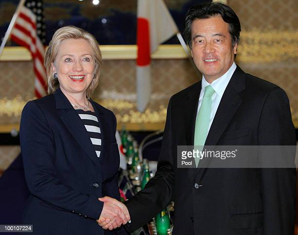 S Secretary of State Hillary Clinton shakes hands with her Japanese counterpart Katsuya Okada before their meeting at the Foreign Ministry's Iikura...