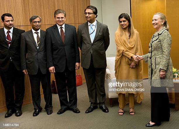 US Secretary of State Hillary Clinton shakes hands with Pakistan's Foreign Minister Hina Rabbani Khar as her delegation looks on before the start of...