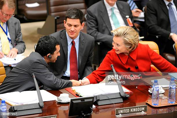 US Secretary of State Hillary Clinton shakes hands with United Arab Emirates' Foreign Minister Abdallah bin Zayid alNuhayyan as British Foreign...
