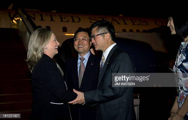 US Secretary of State Hillary Clinton shakes hands with US Ambassador to China Gary Locke and Director General for North American and Oceanian...