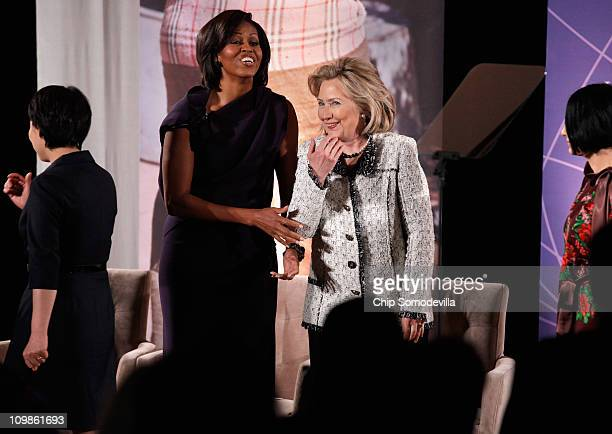 S Secretary of State Hillary Clinton shares a laugh with first lady Michelle Obama during the ceremony for the International Women of Courage Awards...