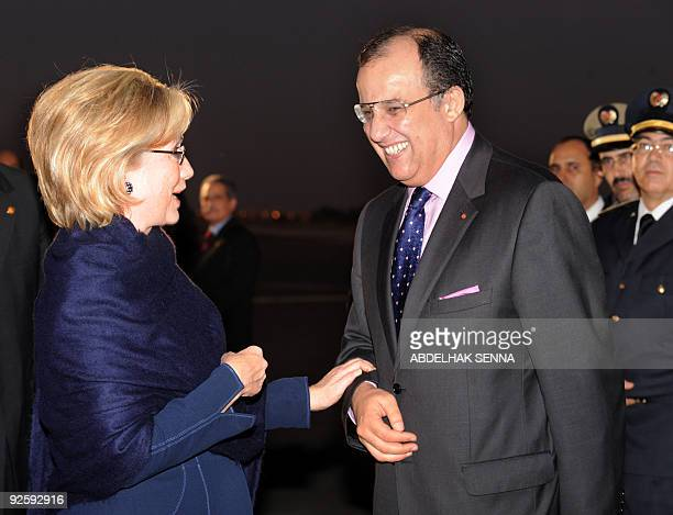 US Secretary of State Hillary Clinton shares a smile with her Moroccan counterpart Taib Fassi Fihri upon her arrival at Marrakech airport early on...