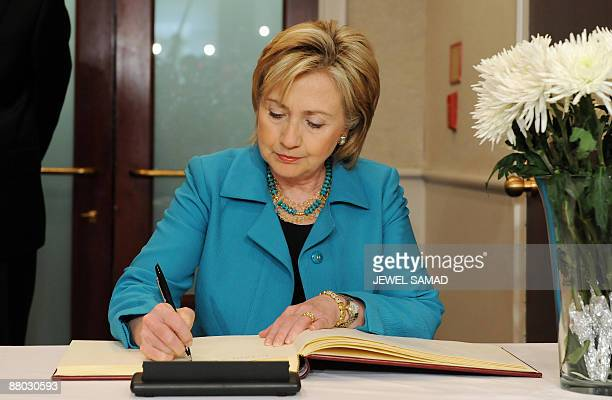 US Secretary of State Hillary Clinton signs a condolence book for late former South Korean president Roh MooHyun as she pays her respect at the South...