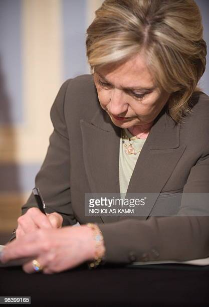 US Secretary of State Hillary Clinton signs the condolence book at the Polish embassy in Washington on April 11 one day after Polish President Lech...