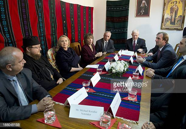 Secretary of State Hillary Clinton sits alongside Father Sava Janjic during a meeting with Ethnic Serb returnees at the St. Nicholas Orthodox Church...