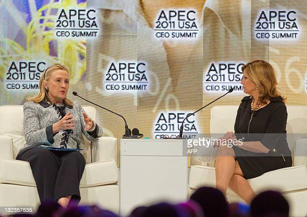 Secretary of State Hillary Clinton speaks as Nina Easton, Washington columnist and senior editor at Fortune, listens during a discussion at the APEC...