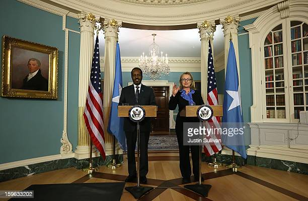 Secretary of State Hillary Clinton speaks as Somali president Hassan Sheikh Mohamud speaks during a news conference on January 17 2013 in Washington...