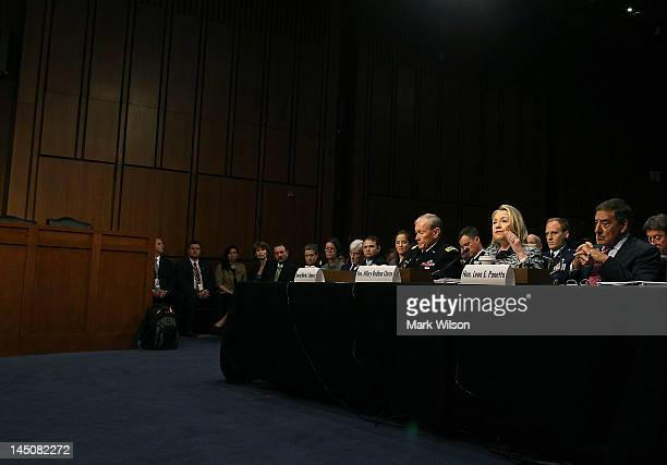 S Secretary of State Hillary Clinton speaks as US Defense Secretary Leon Panetta and Chairman of the Joint Chiefs of Staff Martin Dempsey participate...