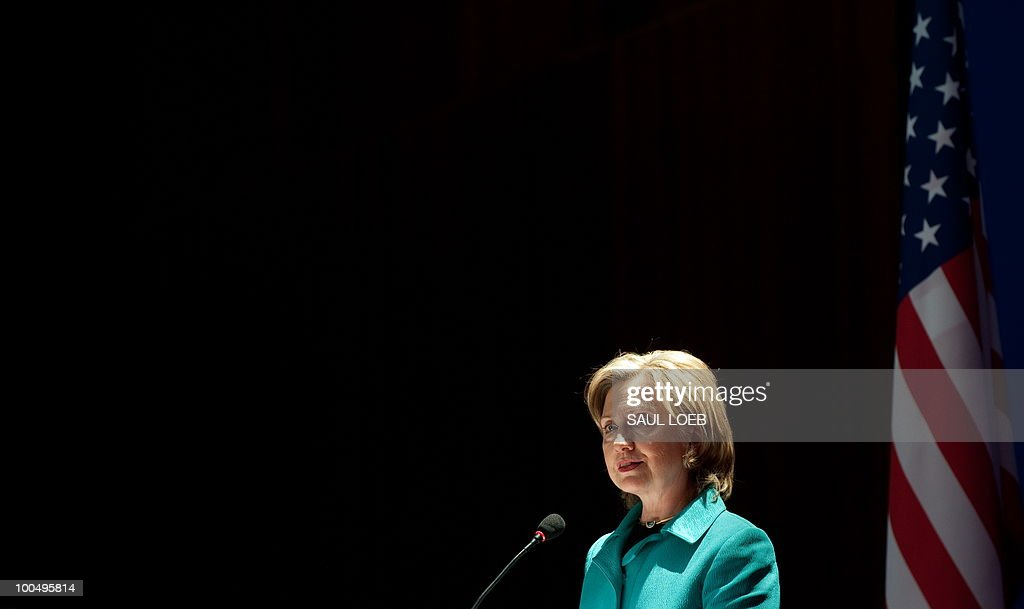 Secretary of State Hillary Clinton speaks before signing the US-China Consultation on People-to-People Exchange agreement at the National Center for the Performing Arts in Beijing on May 25, 2010. The United States and China were wrapping up strategic talks aimed at smoothing out differences on currency and trade issues, as Washington presses Beijing to get tough on North Korea. AFP PHOTO / POOL / Saul LOEB