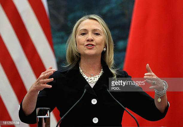 Secretary of State Hillary Clinton speaks during a joint press conference with her Chinese counterpart at the Great Hall of the People in Beijing on...