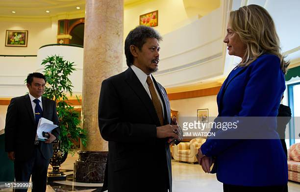 US Secretary of State Hillary Clinton speaks to Brunei's Foreign Minister Prince Mohamed Bolkiah during a visit to the Balai Penghadapan Audience...
