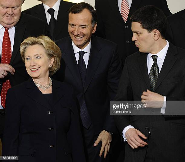 US Secretary of State Hillary Clinton speaks with Italian Foreign minister Franco Frattini and British Foreign minister David Miliband during a...