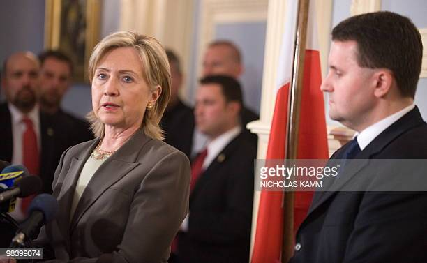 US Secretary of State Hillary Clinton speaks with Polish Ambassador to the US Robert Kupiecki after signing the condolence book at the Polish embassy...