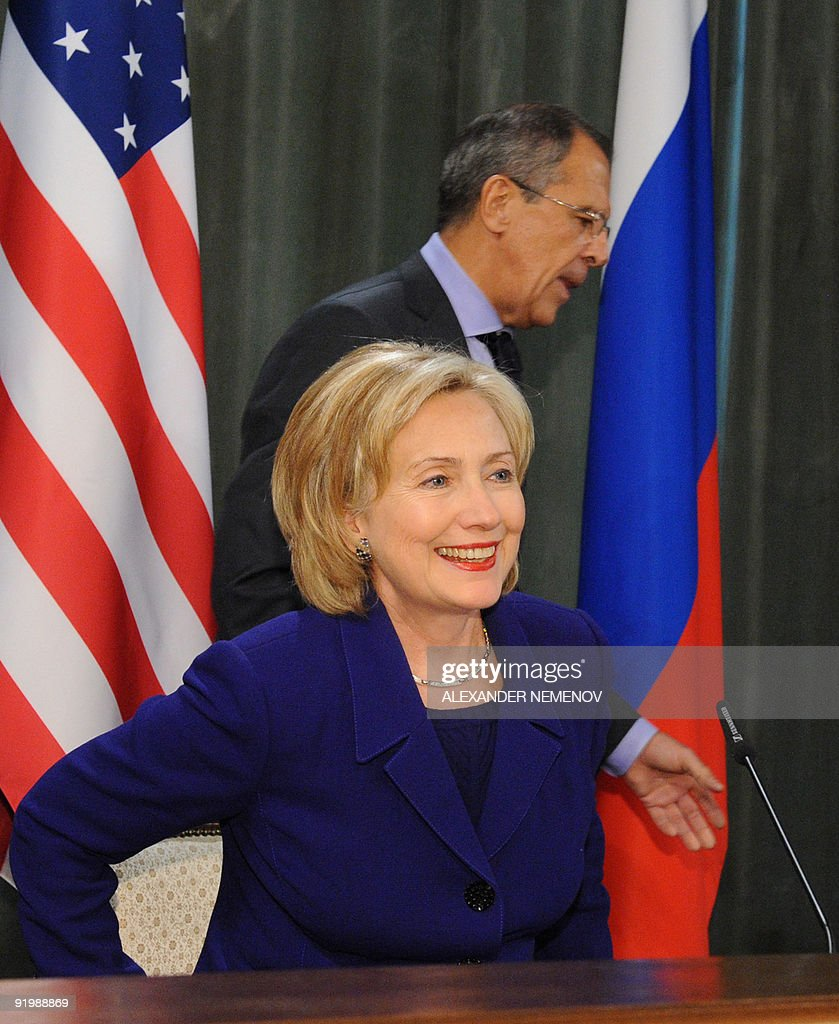 Hillary Clinton Latest News: US Secretary Of State Hillary Clinton Takes Her Seat For A