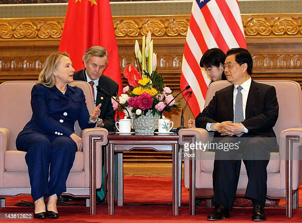 S Secretary of State Hillary Clinton talks to China's President Hu Jintao during a meeting at the Great Hall of the People on May 4 2012 in Bejing...