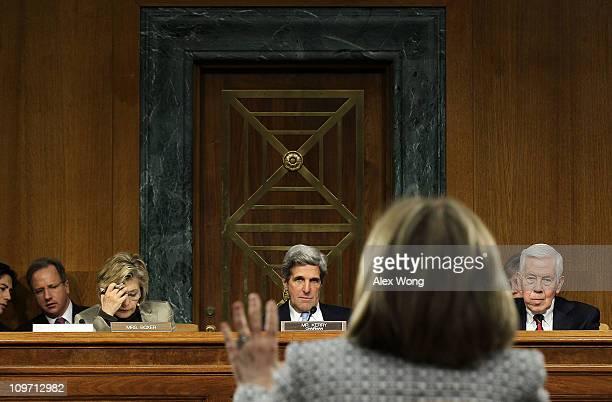 S Secretary of State Hillary Clinton testifies as ranking member Sen Richard Lugar committee chairman Sen John Kerry and Sen Barbara Boxer listen...