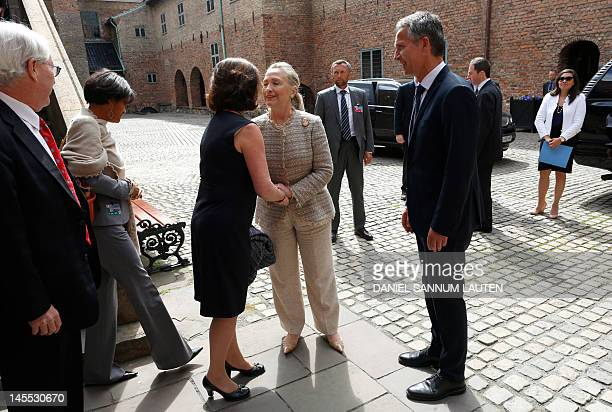 US Secretary of State Hillary Clinton the Prime Minister of Norway Jens Stoltenberg and his wife Ingrid Schulerud greets each other after a lunch at...