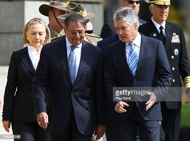 Secretary of State Hillary Clinton US Secretary of Defense Leon Panetta and Australian Minister for Defense Stephen Smith walk to the cenotaph at the...