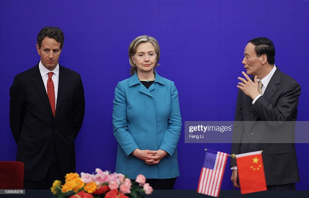 U.S. Secretary of State Hillary Clinton (Center), U.S. Treasury Secretary Timothy Geithner (Left) and China's Vice Premier Wang Qishan (Right) attend a press conference during the China-U.S. Strategic and Economic Dialogue (S&ED) at the Great Hall of People on May 25, 2010 in Beijing, China. Hillary Clinton called upon Beijing to back international pressure against North Korea following the sinking of a South Korean warship, and to seek greater stability in the region.
