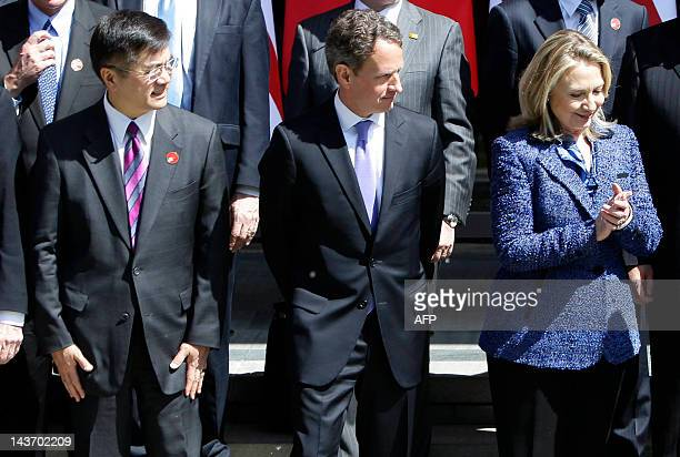 US Secretary of State Hillary Clinton US Treasury Secretary Timothy Geithner and US ambassador to China Gary Locke attend a group photo shoot after...
